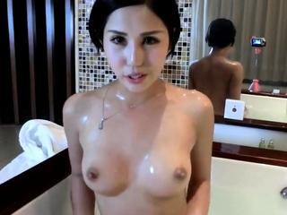 Chinese slut taking a bath with a webcam.