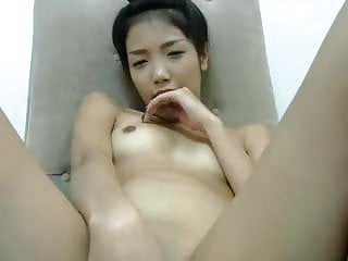 chinese girl playing herself on cell phone